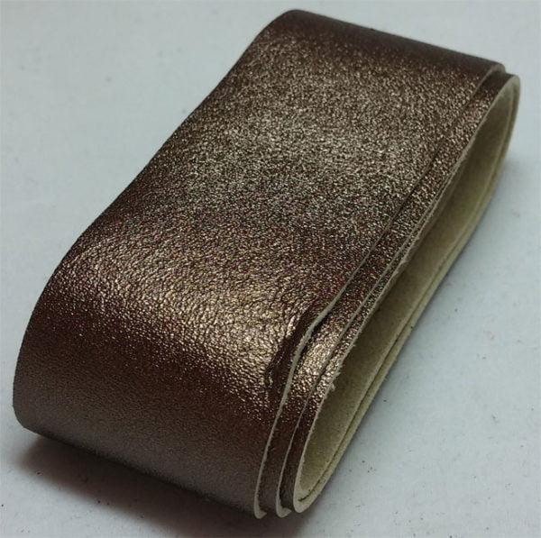 bronze strap of tanned reindeer hide