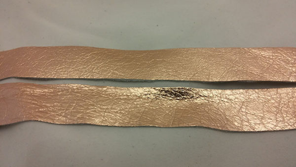 copper strap of tanned reindeer hide