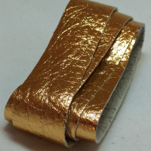 gold strap of tanned reindeer hide