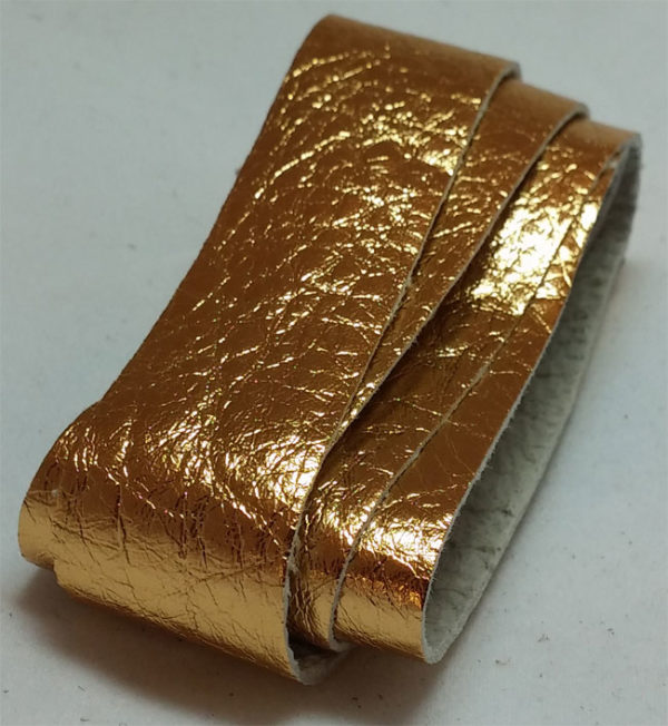 gold strap of tanned reindeer hide