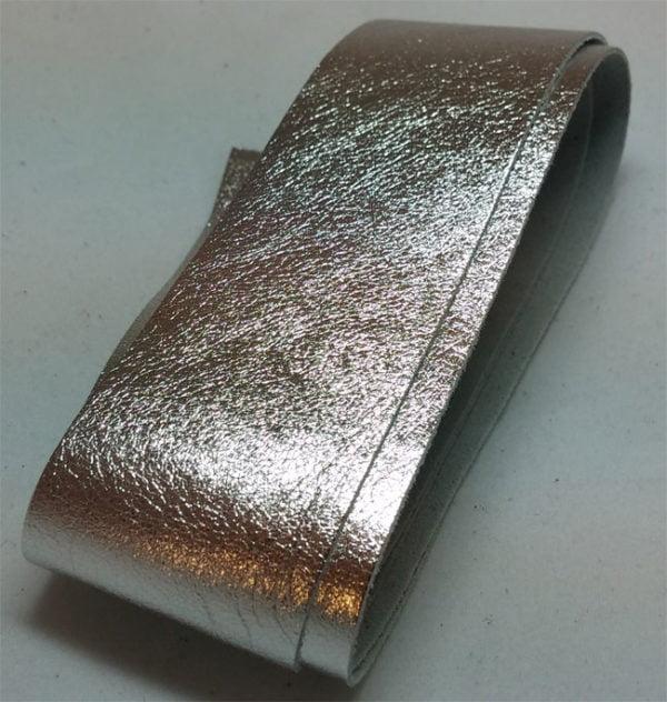 silver strap of tanned reindeer hide
